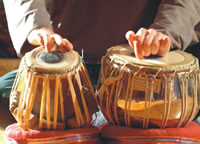 Tonalis Community Music Trainee practising Tablas